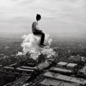 man-sitting-on-a-cloud